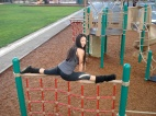 Hanumanasana Pose or Splits on Playground Equipment