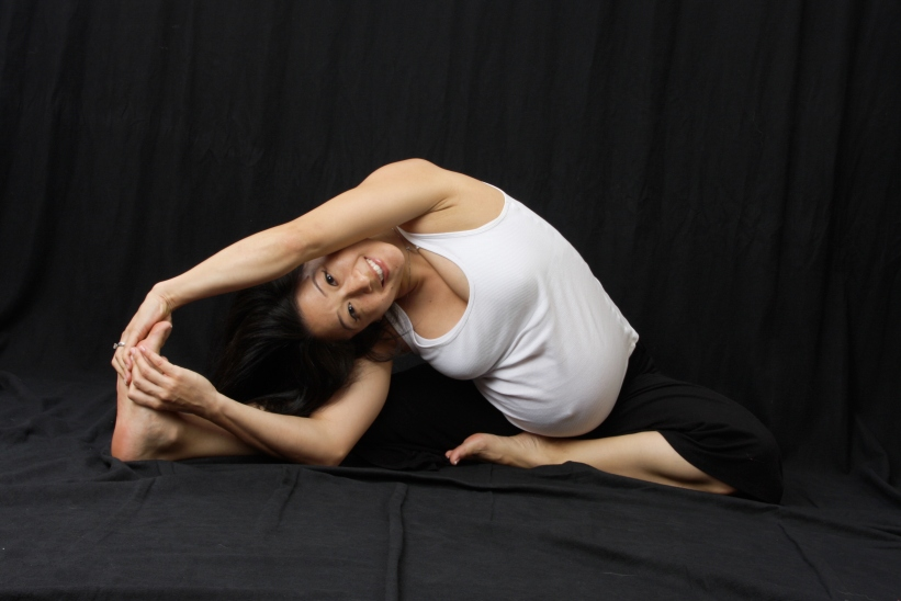 Prenatal Yoga Revolved Head to Knee Pose