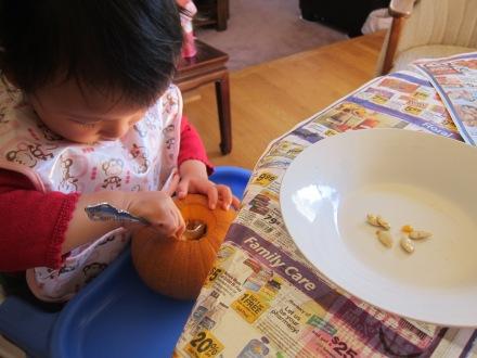Halloween Pumpkin Carving Scooping Seeds